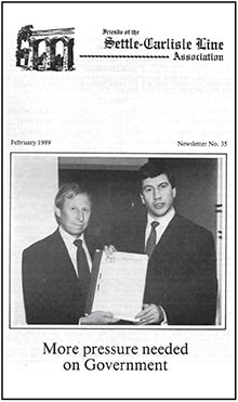 Brian Sutcliffe in 1988 presenting the then Transport Minister, Michael Portillo M.P., with FoSCLA's financial analysis of the line.